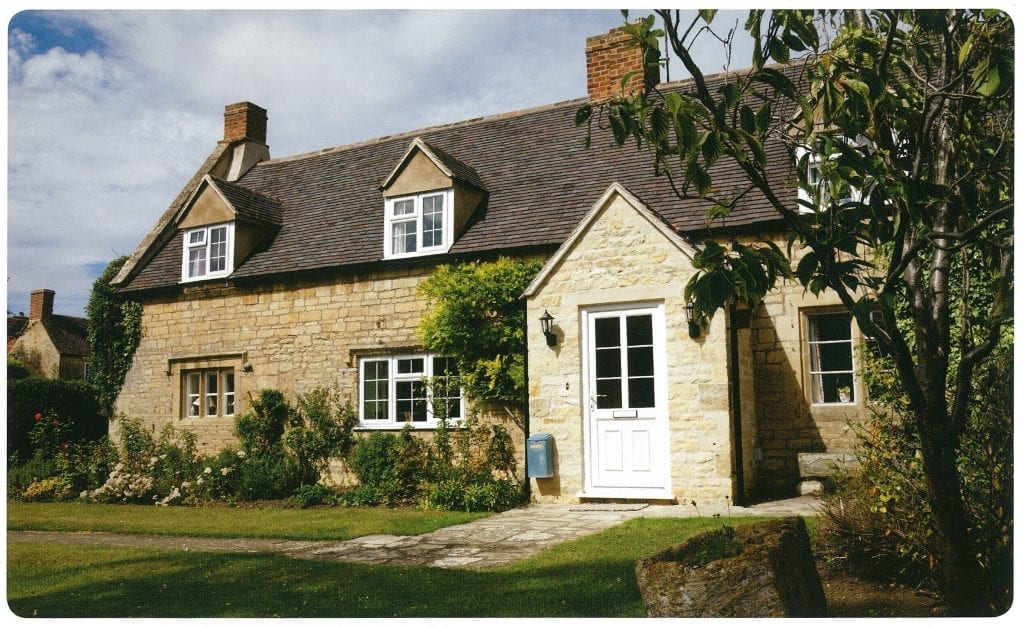 Giraffe Windows and Doors White Front door with glass panels on cottage style house Modern double glazing